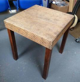 Wicker top wooden table