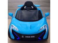Mclaren 12v kids ride on cars. Brand New and Boxed. Scissor doors.
