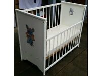 cot with drop side, including a clean mattress. In used but good condition.