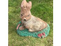 Concrete rabbit garden ornament