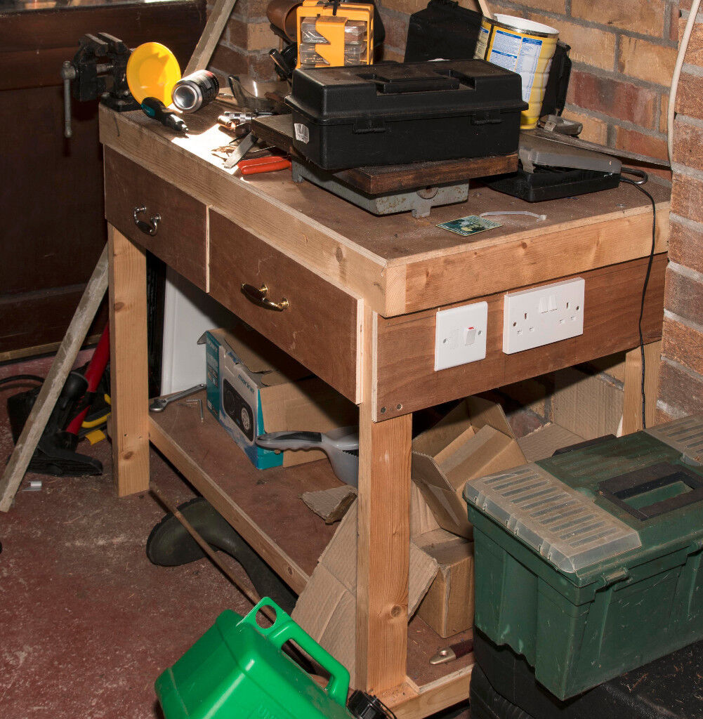 Hand built workbench with electrical sockets and drawers
