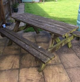 Solid Picnic Table and integral benches, in good condition, although weathered sits up to 8