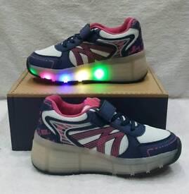 pink and blue light up heelies girls