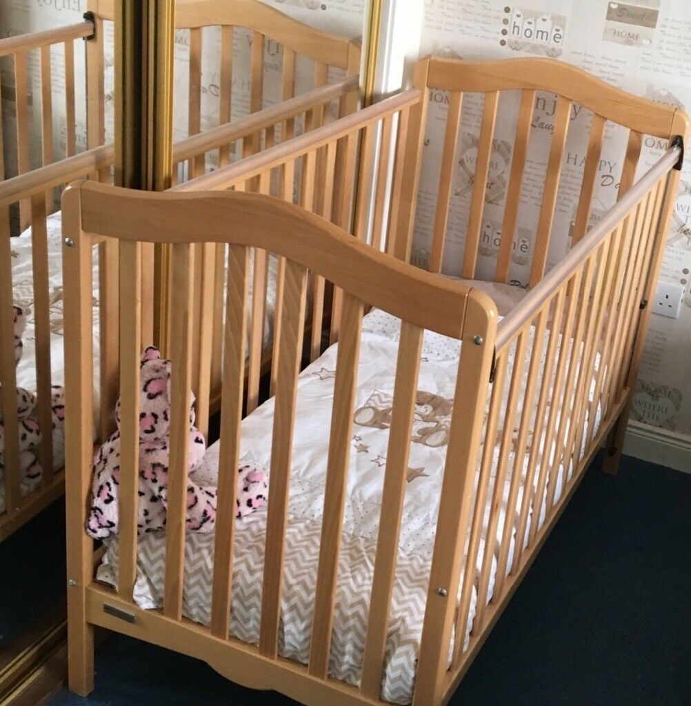 Pine cot complete with one set of bedding .