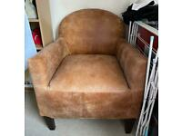 DFS distressed brown leather armchair