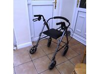 Four-wheeled Rollator for sale. Has a seat and storeage basket