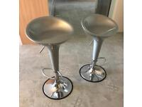2 modern, silver used bar stools with a height adjustable swivel seat