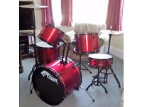 Full size drum kit, hardly used - incl stool and cymbals and pedals . Red. By Tiger Music