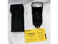 Yunguno Flash, nikon TTL, plus batteries and charger..