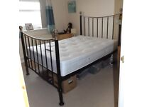 For Sale. A double matress with metal bed frame