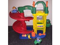 Fisher Price Little People multi-storey garage with two cars and figures