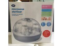 Boots microwave steriliser - fits 4 wide neck bottles. In box with instructions