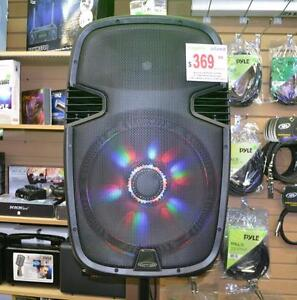 "ACOUSTIC AUDIO 4315TN 15"" 1000 WATT PORTABLE RECHARGEABLE PA SYSTEM W/ 2 BUILT-IN DUAL VHF WIRELESS MICROPHONES AND LED"