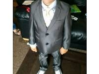 Next grey boys suit with waist coat, white shirt and black tie. Age 5 years