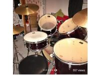 Drum kit with cymbals and a stool. Everything you need to get started