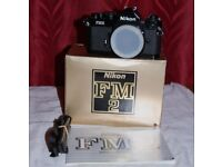 Nikon FM2 black film camera unused brand new condiition boxed with instructions