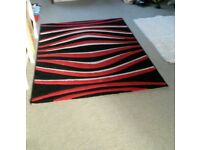 2 Red, black and white rugs