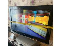 LG tv with wall brackets