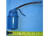 Vintage blue oil can dispenser with flexible spout. See other tools for sale.