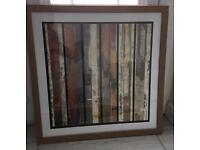 Orange and brown abstract print and frame