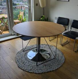 Round oak dining table, black metal legs