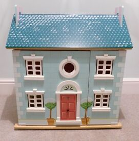 Beautiful wooden dolls house and furniture