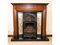 Fire surround with 2kw electric fire and tiled hearth.