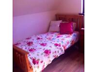 Solid wood single bed with a Kozeesleep Mattress