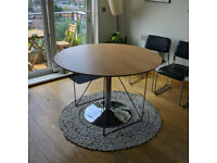 Round oak dining table, black metal legs