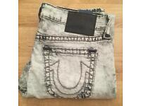 Brand new with tags. Men's True Religion Brand Jeans. Waist 34. Geno slim fit. Super T thick stitch