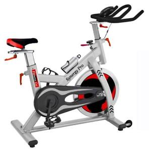 NEW!!! FITNESS GO - SYNERGY PRO - COMMERCIAL SPINNING BIKE - PULSE CHEST STRAP INCLUDED - 48.5 PDS FLYWHEEL - SPD CLIPS