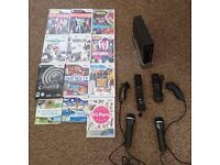 Wii Console by Nintendo (Black) 12 games, 2 controllers, 2 microphones, Great Condition