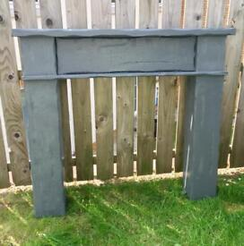 Grey painted fire surround