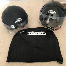 Two motorcycle helmets open face