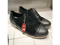Brand new brogues with tags attached