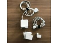 Various Apple MacBook Pro chargers.