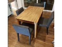 Solid oak table and dining chairs