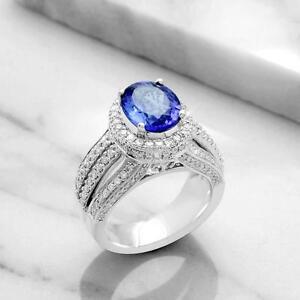 BAGUE AVEC TANZANITE AAA ET DIAMANTS / TANZANITE AAA  AND DIAMOND RING