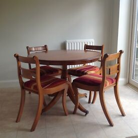 Bevan Funnell Reprodux circular dining table and chairs.