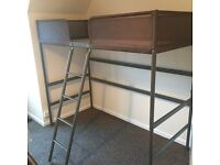 Child's loft style bed with ladder