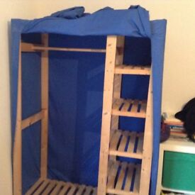 Blue cloth wardroble with shelves and hanging rail
