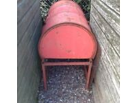 B B Q Large Barrel shaped B B Q on stand.