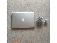 Apple MacBook Pro 5,3 (15-inch Mid 2009) A1286 with software package, charger, lead, and cover