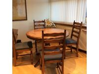 M&S Round/expandable dinning table with 4 chairs.