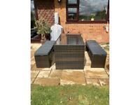 Rattan garden furniture table and benches