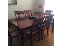 Extending dining room table, 6 chairs and matching sideboard