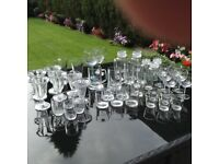Various sized drinking glasses, sweet glasses and side salad dishes, storage jars.