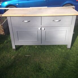 For sale. Very heavy, sturdy sideboard. Perfect for an up cycle project. One drawer needs repairing