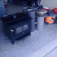 Wood stove and insulated chimney