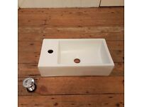 Brand new basin with pop up waste